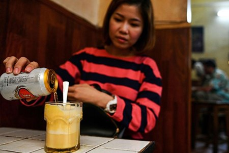 Picture for category Frothed not fried: Hanoi's egg beer draws curious drinkers